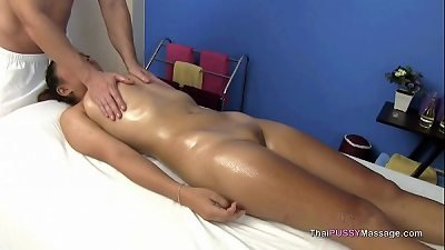Little Asian girl receives oil massage