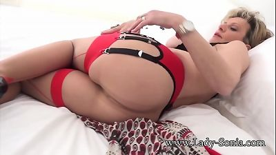lady Sonia stripping and teasing in her lingerie